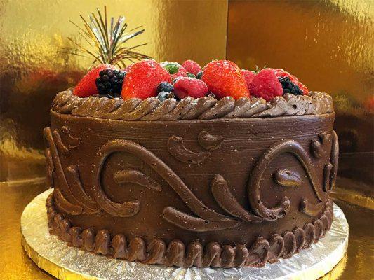 chocolate buttercream cake with gerards signature wedding cake design - dessertsbygerard.com